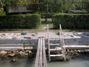 Balatonszárszón vízparti egyszerűen berendezett faház stéggel kiadó