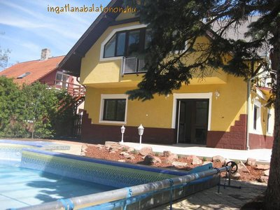 In Zamárdi a waterfront holiday house with a pool is for rent for max 12 people