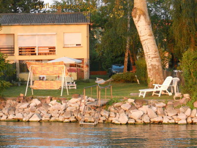 In Szántód a half of a semi-detached house on the waterfront is for rent for max 4+1   people